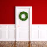 Guirlande de Noël sur le rendu blanc de la porte 3d Photo stock