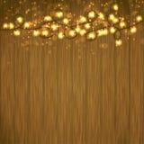 Guirlande lumineuse de lumière de Noël au-dessus de table en bois Images stock