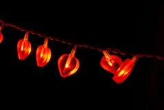 Guirlande rouge rougeoyante Photographie stock libre de droits
