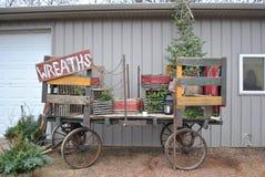 Guirlandes de la publicité de chariot de Noël photographie stock libre de droits