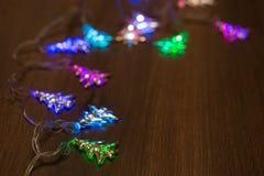 Guirnalda caliente del oro de la Navidad Foto de archivo