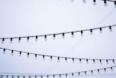 Guirnalda de la calle en un fondo del cielo nublado Fotografía de archivo libre de regalías