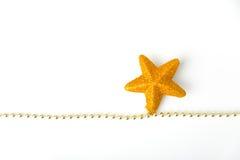 Guirnalda de la estrella del oro Imagen de archivo libre de regalías