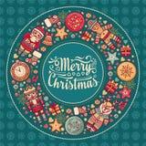 Guirnalda de la Feliz Navidad con los juguetes de la Navidad Imagen de archivo