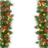 Guirnalda de la Navidad con las decoraciones Imagen de archivo