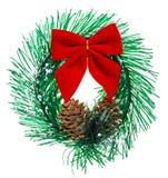 Guirnalda de la Navidad con los conos y el arqueamiento rojo Imágenes de archivo libres de regalías