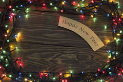 Guirnalda de la Navidad que brilla intensamente con la inscripción Fotografía de archivo libre de regalías