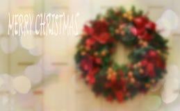 Guirnalda de la Navidad y fondo verdes olivas de Bokeh fotografía de archivo libre de regalías