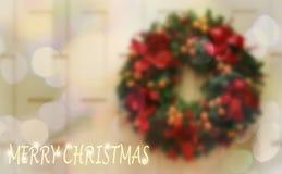 Guirnalda de la Navidad y fondo verdes olivas de Bokeh imagen de archivo libre de regalías