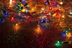 Guirnalda de las luces de la Navidad imágenes de archivo libres de regalías