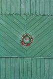 Guirnalda decorativa de la Navidad de ramas del abeto en Foto de archivo