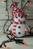 Guirnalda del muñeco de nieve y de la Navidad Fotografía de archivo