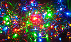 Guirnalda eléctrica, fondo abstracto de la Navidad Foto de archivo