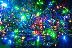 Guirnalda eléctrica, fondo abstracto de la Navidad Imagen de archivo libre de regalías