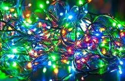 Guirnalda eléctrica, fondo abstracto de la Navidad Imagenes de archivo
