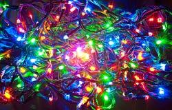 Guirnalda eléctrica, fondo abstracto de la Navidad Foto de archivo libre de regalías
