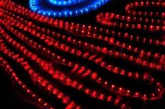Guirnalda eléctrica roja y azul Foto de archivo libre de regalías