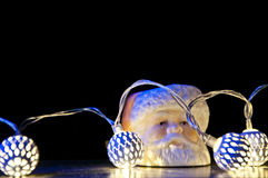 Guirnalda y Papá Noel de la Navidad Imagenes de archivo
