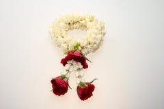 Guirnalda y rosas del jazmín Imagenes de archivo
