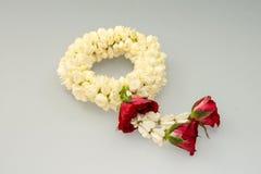 Guirnalda y rosas del jazmín Fotografía de archivo