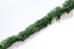 Guirnaldas de la Navidad derecho aisladas en blanco Imágenes de archivo libres de regalías