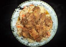 guisado con arroz, las verduras y la salsa imágenes de archivo libres de regalías