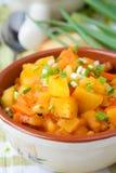 Guisado de la patata con las zanahorias y los tomates Imagen de archivo