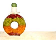 Guisantes partidos en una botella decorativa Fotografía de archivo libre de regalías