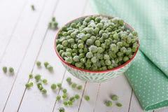 Guisantes verdes congelados Fotos de archivo libres de regalías