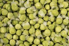 Guisantes verdes congelados Imagenes de archivo
