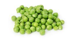Guisantes verdes en el fondo blanco Imagen de archivo