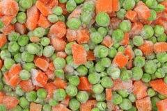Guisantes y zanahorias congelados Imagen de archivo libre de regalías