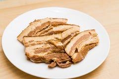 Guise la rebanada del cerdo y las grasas solidificadas de la comida enlatada fotos de archivo libres de regalías