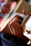 Guitar. Man playing on guitar Royalty Free Stock Images