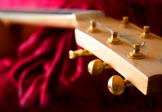 Guitar. Head. The six-string acoustic  waits for the musician Royalty Free Stock Photos