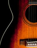 Guitar. Close-up of acoustic guitar on black background Royalty Free Stock Photography