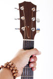 Guitar. Hand holding a headstock of a classical guitar Royalty Free Stock Photography