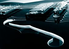 Guitar. Vintage electric guitar detail monochrome in blue stock image