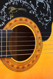 Guitar. Closeup of Guitar shows the artistic design that creates beautiful music Royalty Free Stock Image