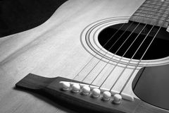 Guitar. A closeup of an abstract classical acoustic guitar with strings stock photography