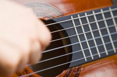 Guitar. Hand playing on tool string guitar Royalty Free Stock Photo