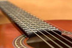 Guitar. Acoustic string strings sound hole rosette purfling fingerboard fret frets fretboard horizontal royalty free stock images