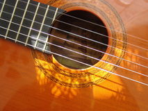 Guitar. Close-up an acoustic guitar's strings across the sound hole Stock Images