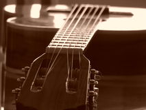 Guitar. On Table in Sepia Royalty Free Stock Image