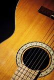 Guitar. Spanish guitar on black background Stock Photos