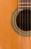 Guitar. Classic wood guitar closeup for  background Royalty Free Stock Photo