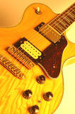 Guitar. Rock n' roll guitar with pick up in focus Royalty Free Stock Image