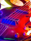 Guitar. High decorated and light illuminated part of guitar and it strings Stock Images