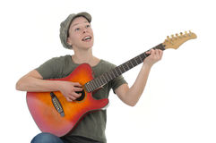 Guitar. Woman singing and playing on her guitar Royalty Free Stock Image