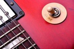 Guitar. Closeup of a red electric guitar near the bridge Royalty Free Stock Image